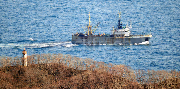 Fishing vessel returning to harbor  Stock photo © papa1266