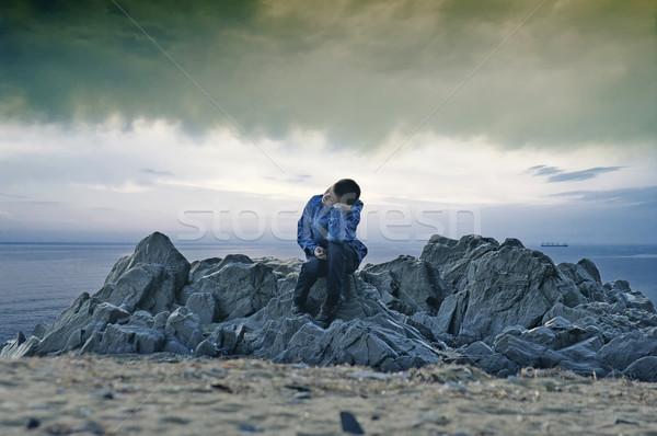 Nino mar sesión rocas nubes de tormenta sueños Foto stock © papa1266