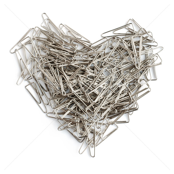 Stationery love concept. Heart shaped staples background. Stock photo © pashabo