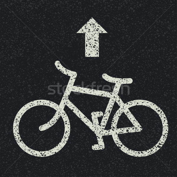 Bicycle road sign and arrow on asphalt background. Vector Stock photo © pashabo