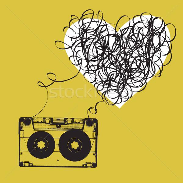 Audiocassette with tangled tape. Haert shaped Stock photo © pashabo
