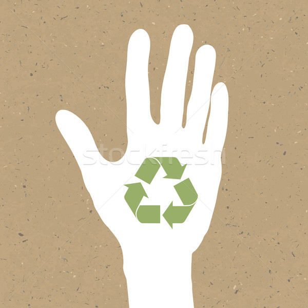 Reuse sign on hand silhouette on recycled paper. Vector, EPS10 Stock photo © pashabo