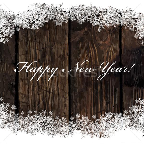 Happy New Year! Greeting on Wooden Background. Snowflakes border Stock photo © pashabo