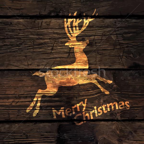 Karácsony üdvözlőlap ragyogó arany szarvas sziluett Stock fotó © pashabo
