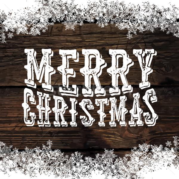 Merry Christmas! Greeting Tag on Wooden Background. Snowflakes b Stock photo © pashabo