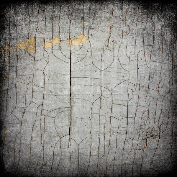 Cracked texture of old paint. Stock photo © pashabo