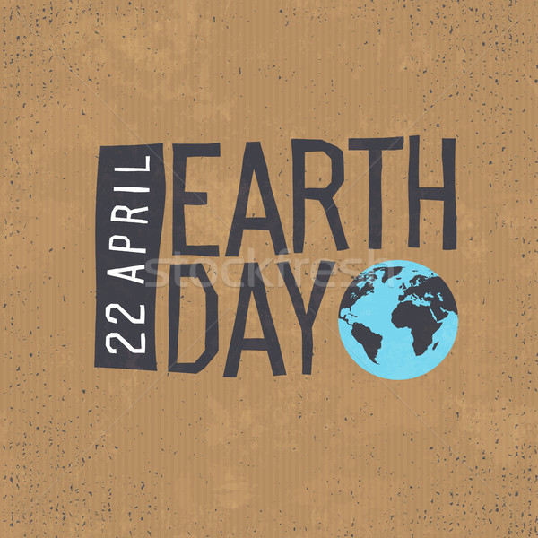 Earth day, 22 April text with globe symbol on cardboard  texture Stock photo © pashabo