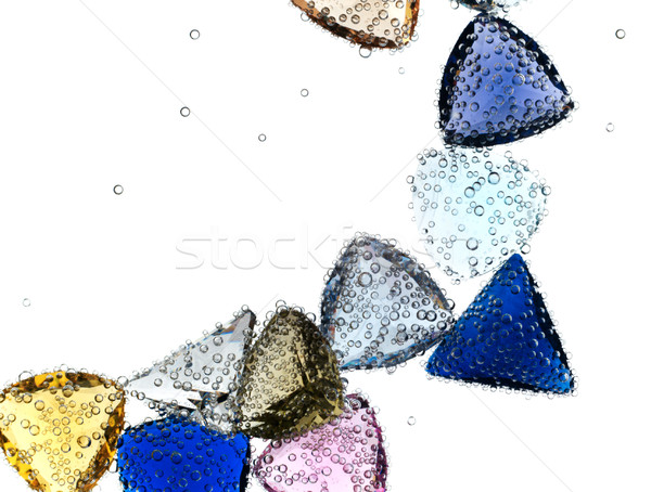 Stock photo: Gems falling in pure water against white.