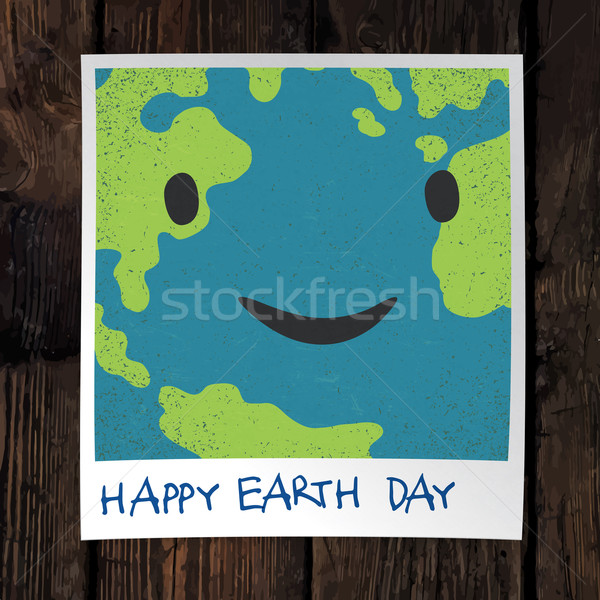 Photo frame with Earth snapshot closeup. Earth day concept. On w Stock photo © pashabo