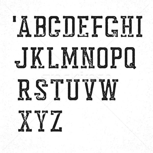 Retro serif typeface. Stamped grunge alphabet. Isolated on white Stock photo © pashabo