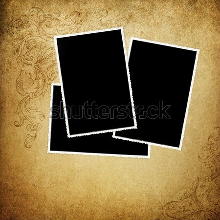 Old empty vintage photos on decorated background. Stock photo © pashabo