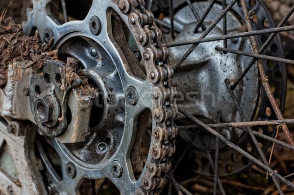 Enduro motorbike wheel and chain. Closeup shot Stock photo © pashabo