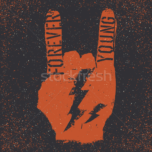 Forever young. Grunge lettering with Rock On gesture and thunder Stock photo © pashabo