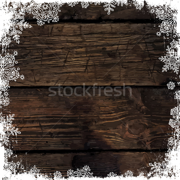 Wooden brown christmas background with snowflakes. Frozen orname Stock photo © pashabo