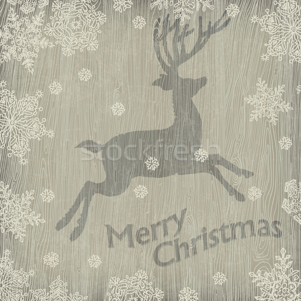 Christmas deer with snowflakes on wooden texture. Vector illustr Stock photo © pashabo