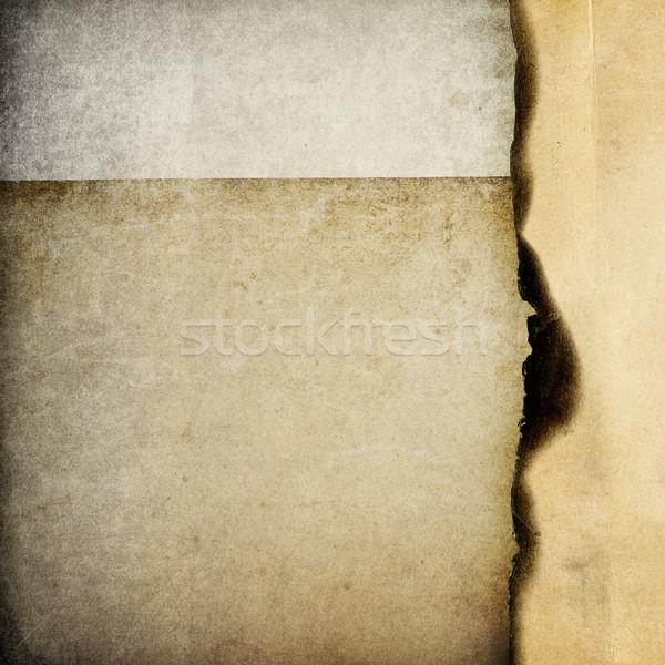 Vintage burned paper background, isolated on white. Stock photo © pashabo
