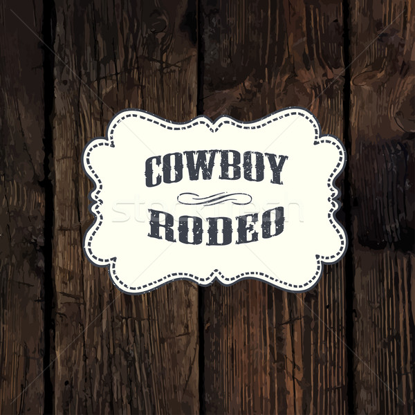 Western styled label on aged wooden wall background Stock photo © pashabo