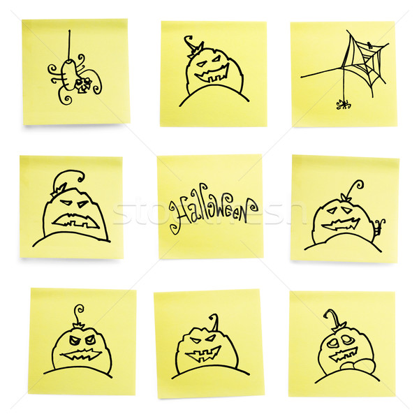Stock photo: Yellow sticky papers set with some Halloween doodles.
