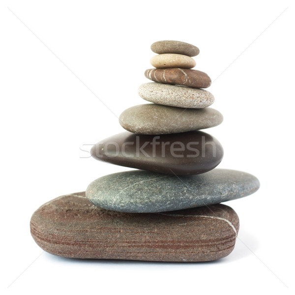 Pebble stones tower isolated on white background. Stock photo © pashabo