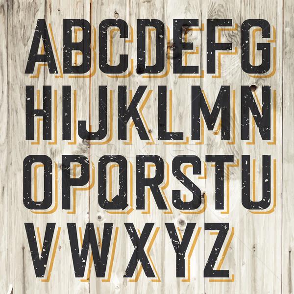 Retro Styled Alphabet on Wooden Background Stock photo © pashabo