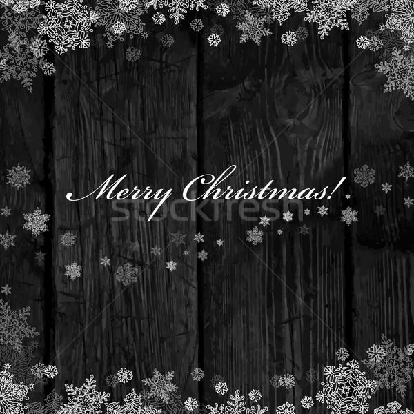 Wooden black christmas background with snowflakes. Holiday Postc Stock photo © pashabo