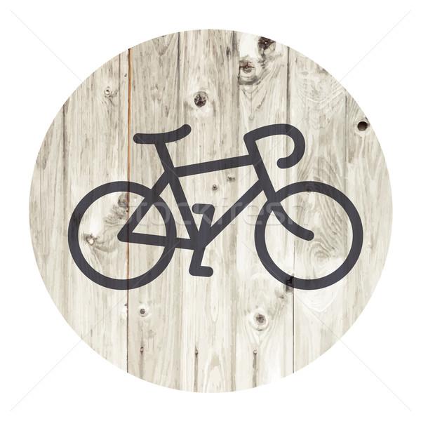 Bicycle minimalistic icon on aged wooden wall background Stock photo © pashabo