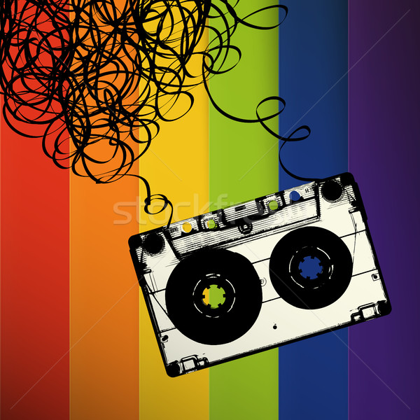 Audiocassette tape with tangled. On rainbow stripes background Stock photo © pashabo