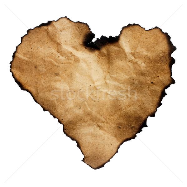 Burned heart-shaped paper isolated on white. Stock photo © pashabo