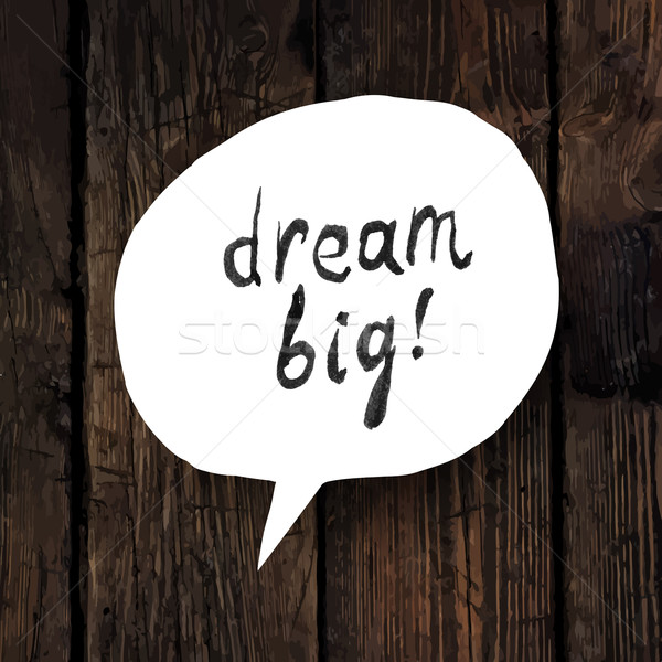 'Dream big' lettering in speech bubble on wooden texture Stock photo © pashabo