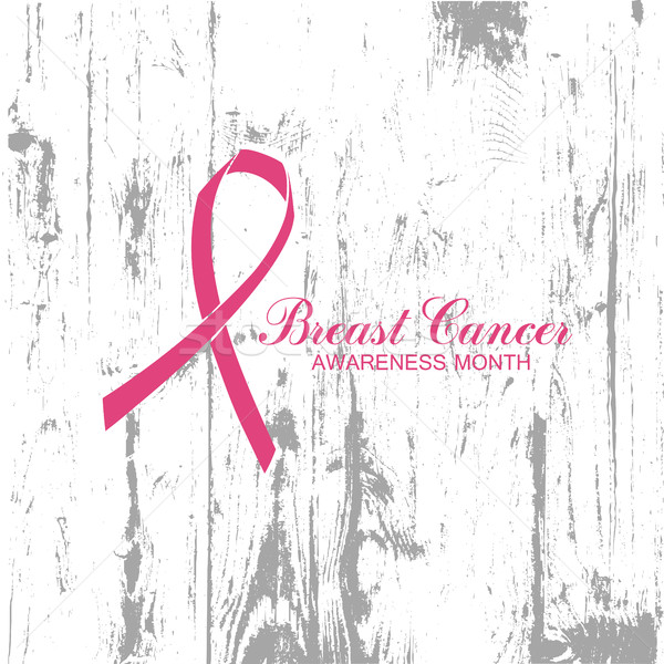Ribbon of Breast Cancer on abstract wooden background. Stock photo © pashabo