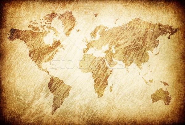 Grunge rubbed map of the world background. Stock photo © pashabo