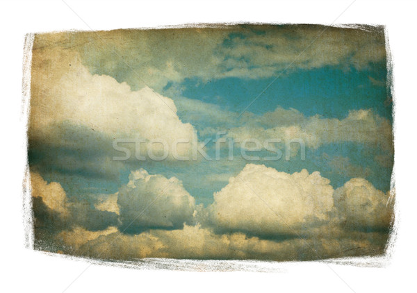 Vintage sky with fluffy clouds isolated in painted frame on whit Stock photo © pashabo