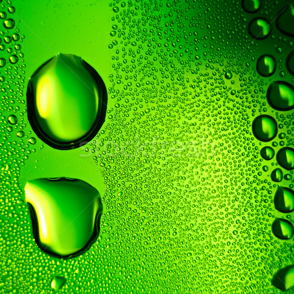 Green water drops background. Square composition. Stock photo © pashabo