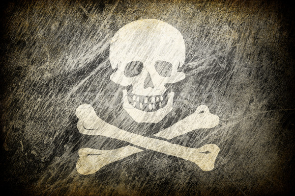 Grunge rubbed flag of Jolly Roger. Stock photo © pashabo