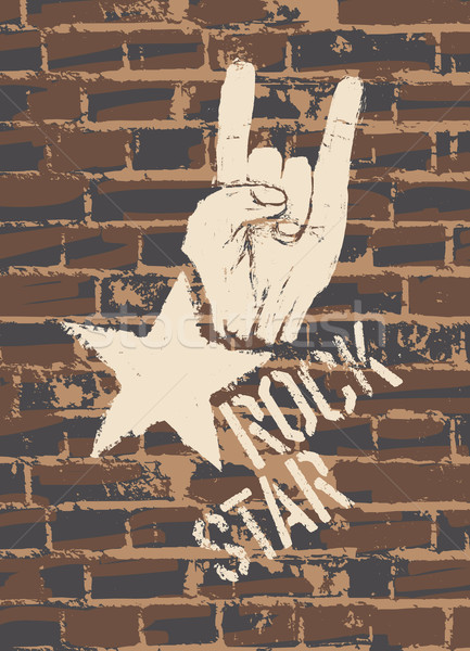 Rock Star Sign With Horns Gesture On Brick Wall Stock photo © pashabo