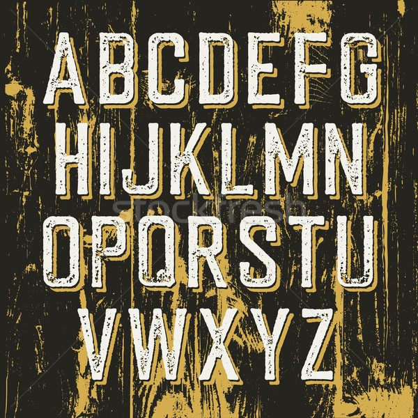 Vintage retro typeface on wooden texture with shadow. Stamped al Stock photo © pashabo