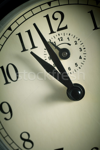 Hands pointing to midday on clock face Stock photo © pashabo