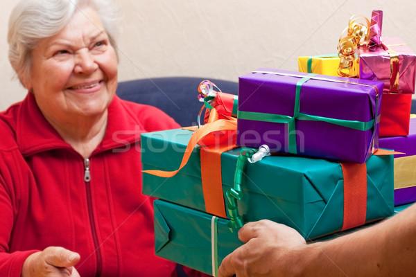Feminino senior dar muitos presentes festa Foto stock © Pasiphae