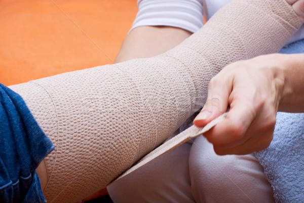 Nurse bandaged the foot of a patient Stock photo © Pasiphae