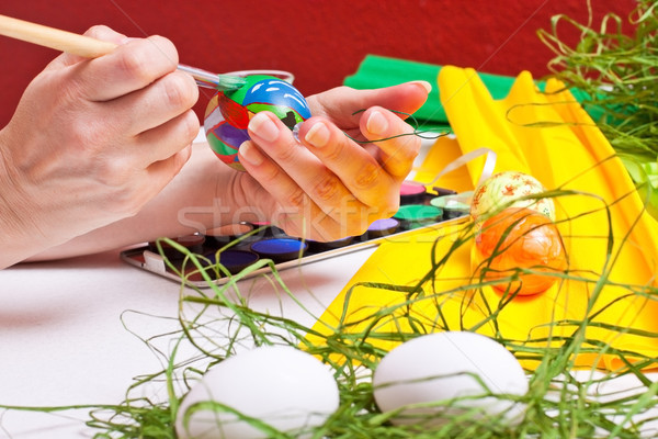 table full of colorful Easter eggs Stock photo © Pasiphae
