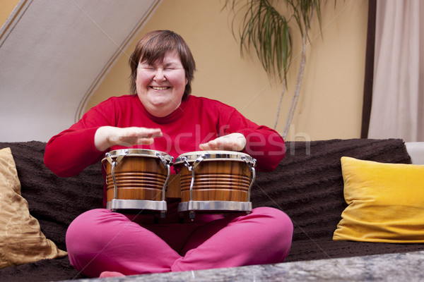 Mentally disabled woman with music therapy Stock photo © Pasiphae