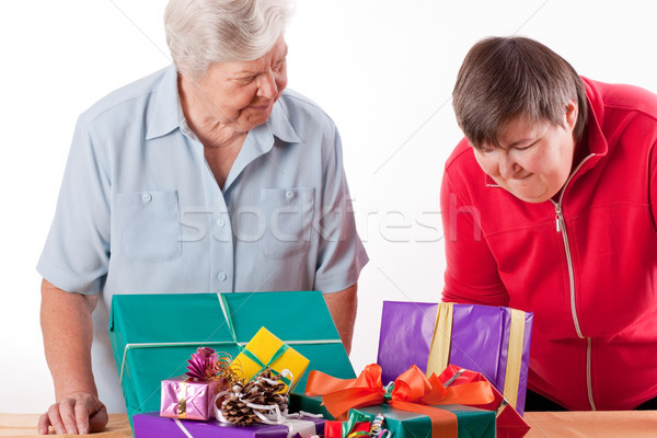 Senior with mentally handicapped woman consider gifts Stock photo © Pasiphae