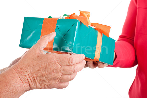 closeup, hands reaching each other a gift Stock photo © Pasiphae