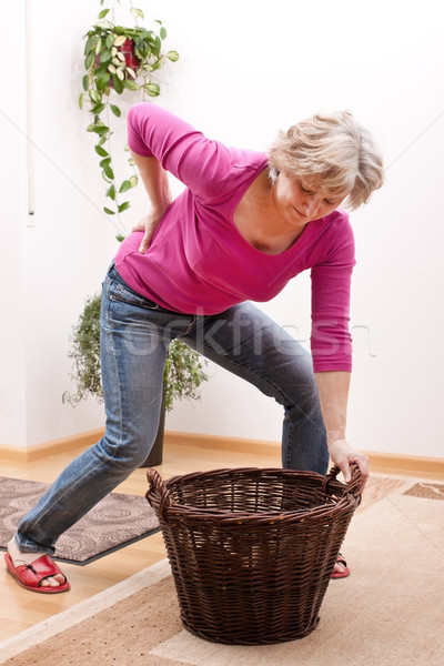 Senior has back pain due to heavy load Stock photo © Pasiphae