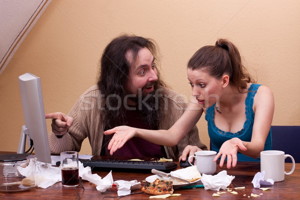 Nerd points to monitor and woman is annoyed by the garbage Stock photo © Pasiphae