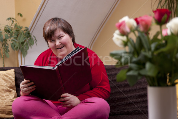 Mentally disabled woman reading a book Stock photo © Pasiphae