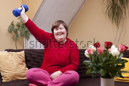 Disabled woman focused on music Stock photo © Pasiphae