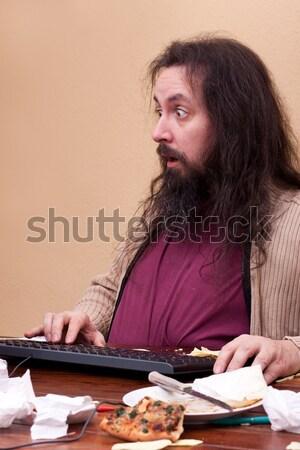Hosszú hajú férfi mocskos munkahely papír egér Stock fotó © Pasiphae