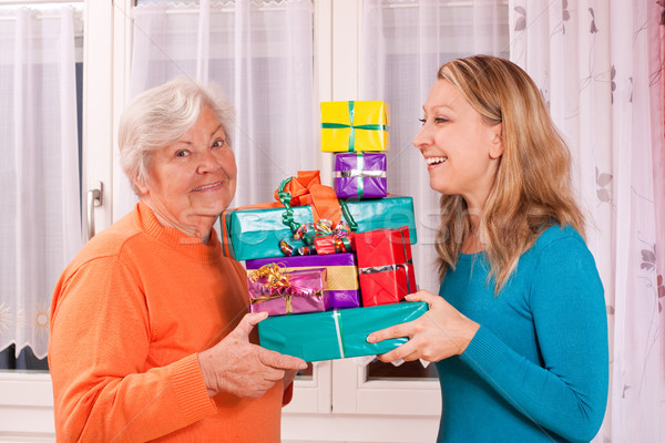 old and young woman holding gifts Stock photo © Pasiphae