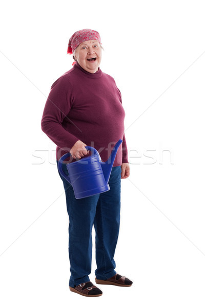 Senior holding a watering can Stock photo © Pasiphae